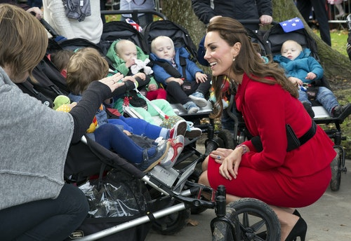 Britain's Catherine, the Duchess of Cambridge, talks with five sets of twins and their mothers during a walkabout in Christchurch