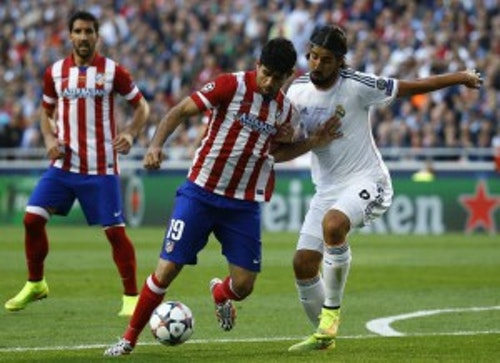 Atletico Madrid's Costa and Real Madrid's Khedira challenge for the ball during their Champions League final soccer match at the Luz Stadium in Lisbon