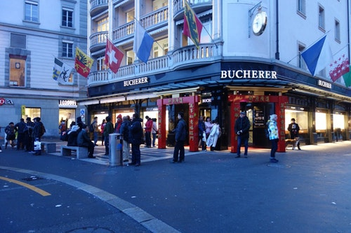 Chinese New Year couplets outside watch boutiques in Luzern to attract Chinese tourists during the New Year.