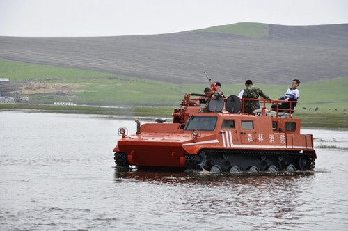 The hulunbeir grassland flooded after a storm and the government transported students with armored cars. Photo Credit: Reuters