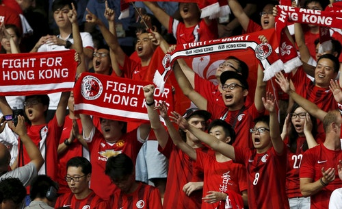 Fans of Hong Kong's soccer team shout during their World Cup qualifying match against China in Shenzhen