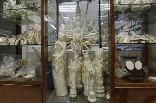 Products from elephant ivory are displayed on the centre column of a shelf inside a carving and jewellery factory in Hong Kong