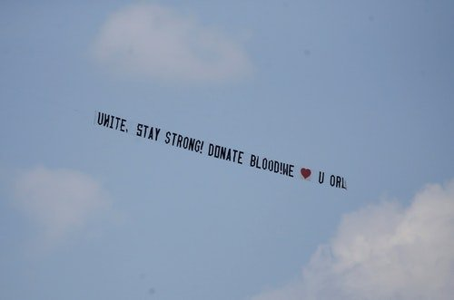 A message towed by an airplane urges people to donate blood, after a mass shooting at a gay nightclub in Orlando