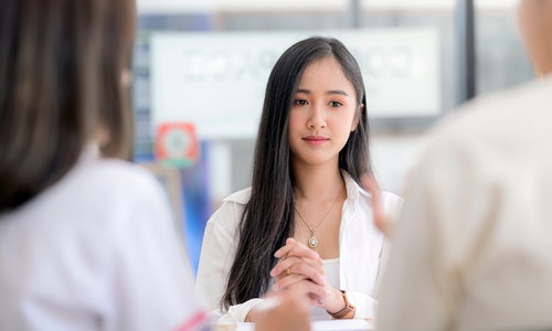 Young asian women feel unconfident and worried while interviewing for a job in modern office.